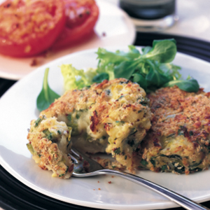 Home-style potato cakes with baked tomatoes