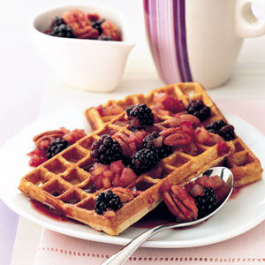 Pecan waffles with maple and blackberry sauce