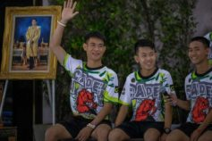 Ekkapol Chantawong (Left), coach of the 'Wild Boars' soccer team speak during a press conference for the first time since they were rescued from a cave in northern Thailand